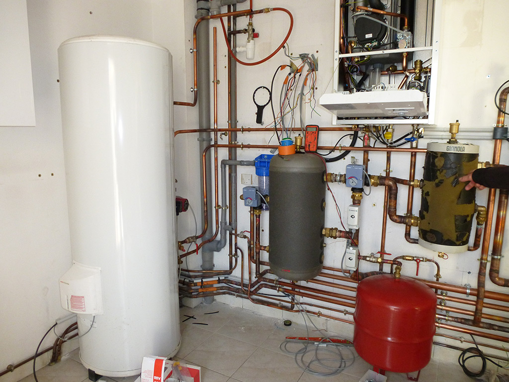 Jean marc sol installation salle de bains cl s en main for Installation chaudiere gaz murale